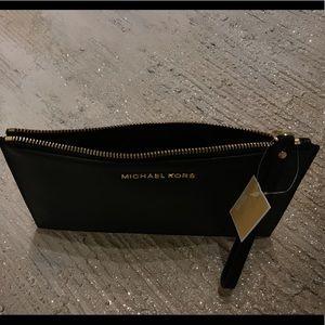 Michael Kors Bags - MICHAEL KORS leather pouch .